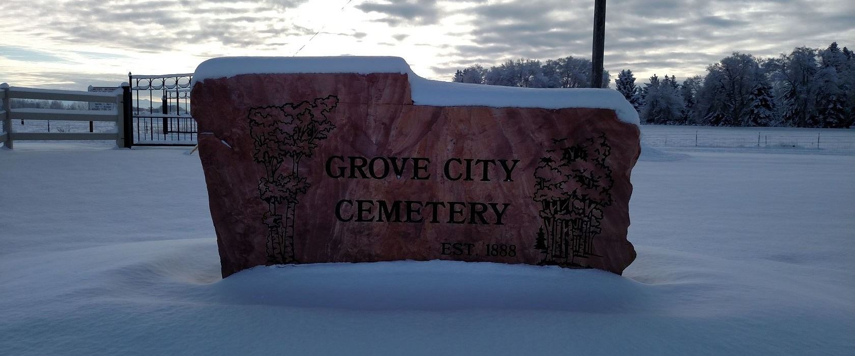 Picture of the new stone cemetery sign.