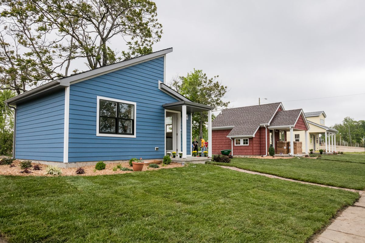 This is a picture of two tiny houses in a tiny house subdivision.