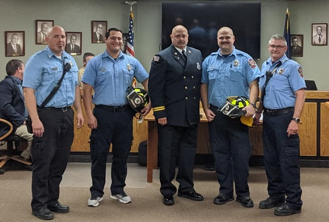 PICTURE OF NEWLY PROMOTED FIREFIGHTERS AND THEIR CAPTAINS